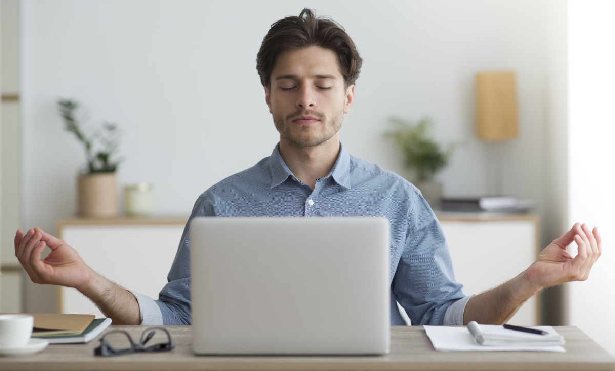 Man on laptop, relaxed pose